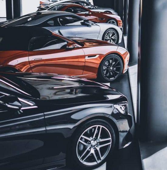 a few modern cars in a row